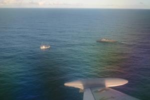 ROU 34 Audaz intercepting an illegal brazilian fishing vessel on Uruguayan Atlantic coast, 6 nm f